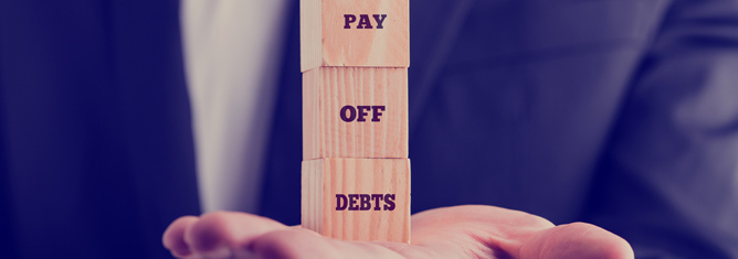 Extra cash in the bank? Should you pay down your debt or invest?